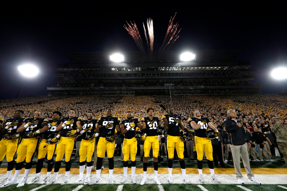The Iowa Hawkeyes stand for the National Anthem before their game against the Wisconsin Badgers Saturday, September 22, 2018 at Kinnick Stadium. (Brian Ray/hawkeyesports.com)