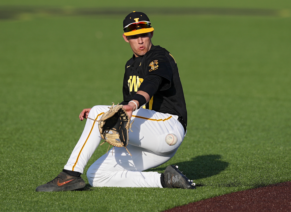 Iowa shortstop Dylan Nedved (17) fields a ground ball during the fifth inning of their college baseball game at Duane Banks Field in Iowa City on Tuesday, March 10, 2020. (Stephen Mally/hawkeyesports.com)