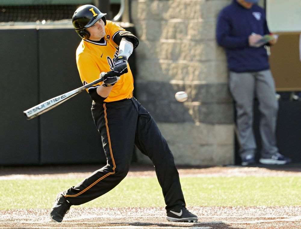 Iowa Hawkeyes catcher Brett McCleary (32) drives a pitch for a hit during the second inning of their game at Duane Banks Field in Iowa City on Tuesday, Apr. 2, 2019. (Stephen Mally/hawkeyesports.com)