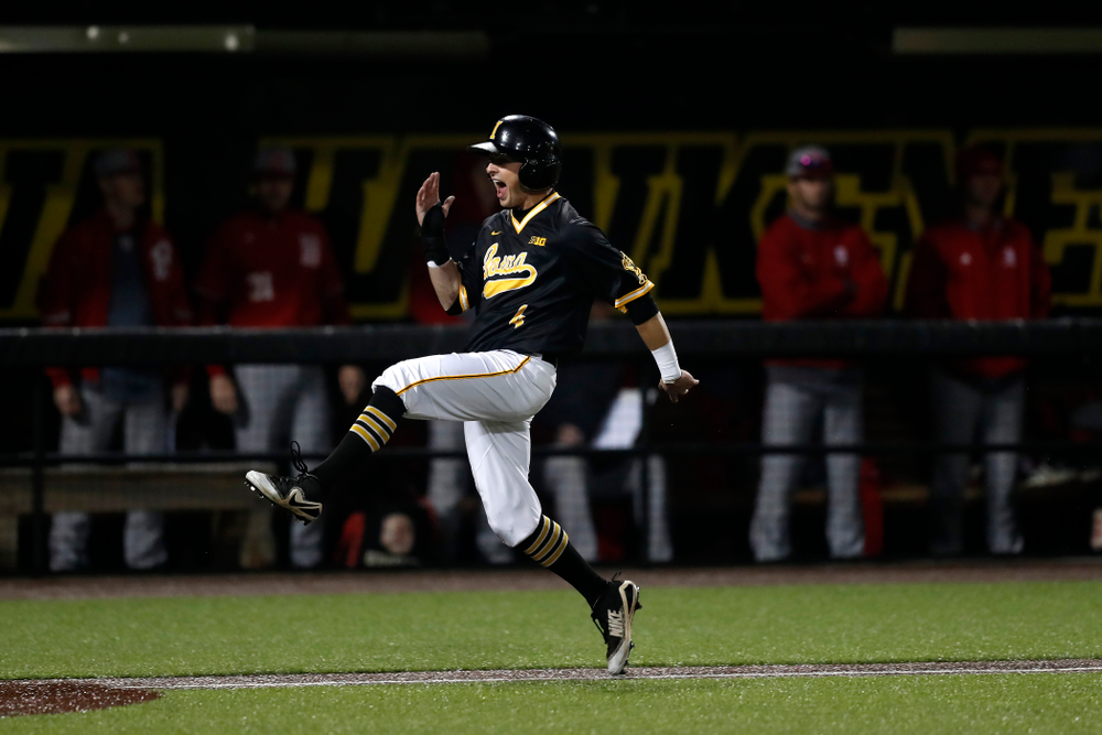 Iowa Hawkeyes infielder Mitchell Boe (4) celebrates as he scores on a walk off grand slam by catcher Tyler Cropley (5) in the bottom of the ninth against the Bradley Braves Wednesday, March 28, 2018 at Duane Banks Field. (Brian Ray/hawkeyesports.com)