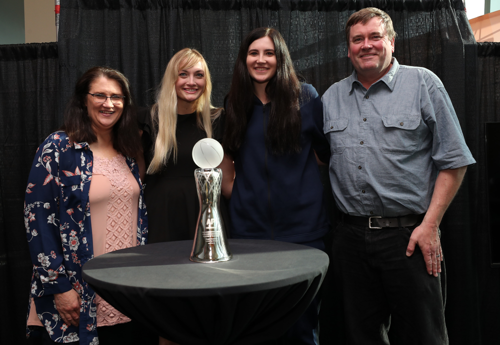 Iowa Hawkeyes forward Megan Gustafson (10) poses for  photo with her family Eva, Clendon, and Emily after winning the Associated Press Player Of The Year during a news conference Thursday, April 4, 2019 at Amalie Arena in Tampa, FL. (Brian Ray/hawkeyesports.com)