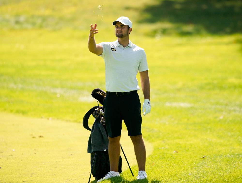 Iowa's Gonzalo Leal throws gas in the wind as he checks the wind during the second day of the Golfweek Conference Challenge at the Cedar Rapids Country Club in Cedar Rapids on Monday, Sep 16, 2019. (Stephen Mally/hawkeyesports.com)