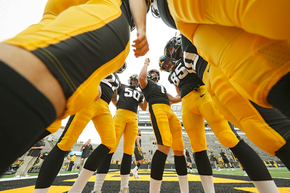 Iowa Hawkeyes punter Colten Rastetter (7) talks as he huddles with the special teams unit before their game at Kinnick Stadium in Iowa City on Saturday, Sep 28, 2019. (Stephen Mally/hawkeyesports.com)