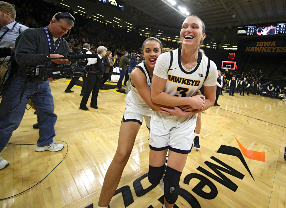 Iowa Hawkeyes guard Gabbie Marshall (24) and guard Makenzie Meyer (3) celebrate after their double overtime win at Carver-Hawkeye Arena in Iowa City on Sunday, January 12, 2020. (Stephen Mally/hawkeyesports.com)
