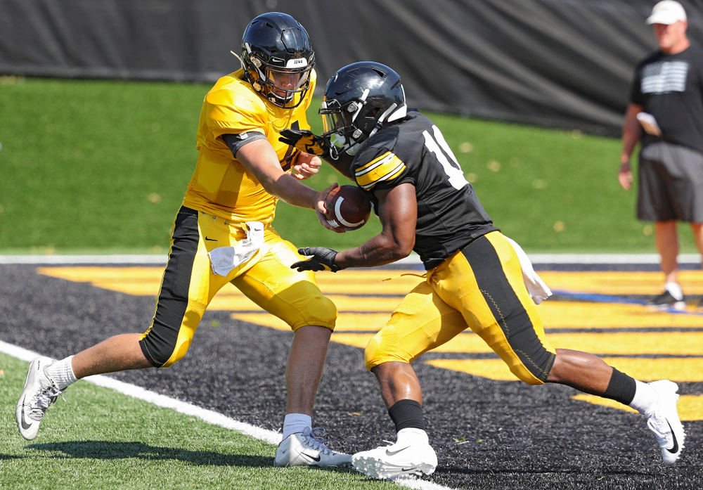 Iowa Hawkeyes quarterback Nate Stanley (4) hands the ball off to running back Mekhi Sargent (10) during Fall Camp Practice #5 at the Hansen Football Performance Center in Iowa City on Tuesday, Aug 6, 2019. (Stephen Mally/hawkeyesports.com)