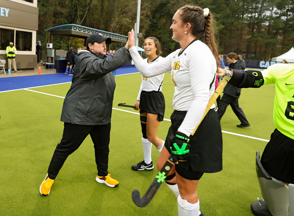 Iowa head coach Lisa Cellucci gives a high-five to Anthe Nijziel (6) after winning their NCAA Tournament First Round match against Duke at Karen Shelton Stadium in Chapel Hill, N.C. on Friday, Nov 15, 2019. (Stephen Mally/hawkeyesports.com)
