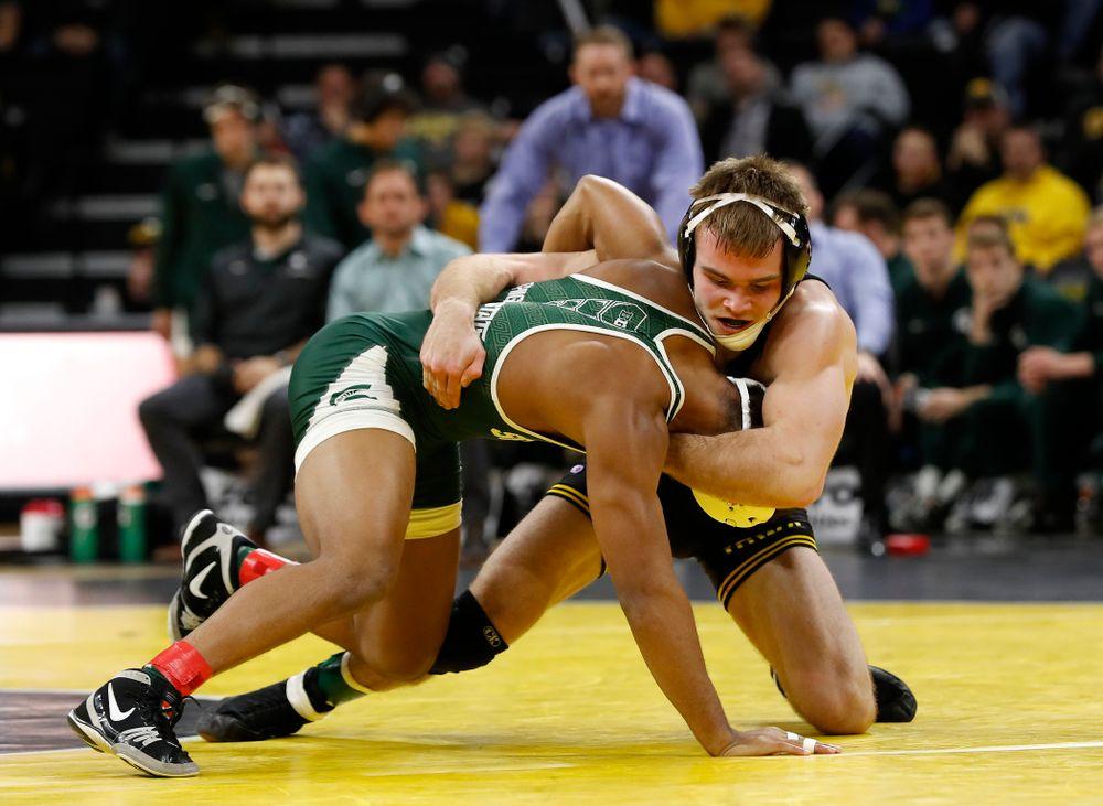 Iowa's Brandon Sorensen pins Michigan State's Jwan Britton at 149 pounds