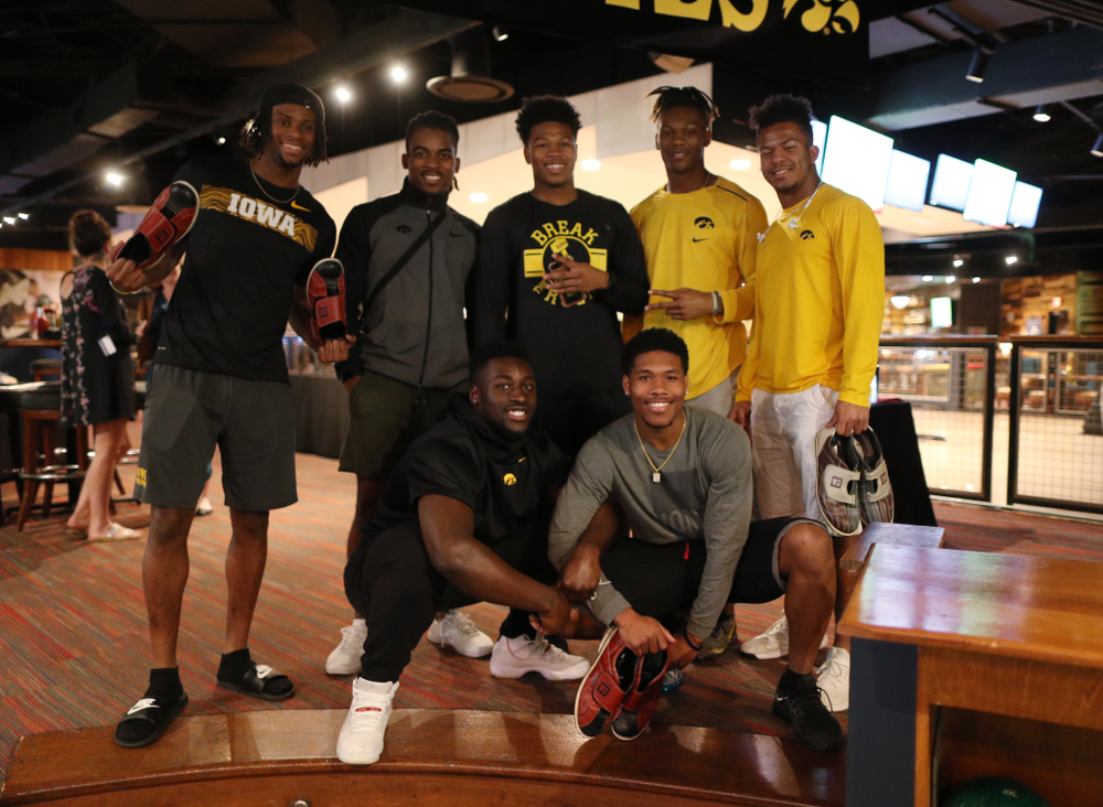 Iowa Hawkeyes wide receiver Ihmir Smith-Marsette (6),defensive back Devonte Young (17), defensive back Kaevon Merriweather (26), wide receiver Brandon Smith (12), running back Ivory Kelly-Martin (21), linebacker Amani Jones (52), and wide receiver Tyrone Tracy Jr. (3) during the Players' Night at Splitsville Friday, December 28, 2018 in the Sparkman Wharf area of Tampa, FL.(Brian Ray/hawkeyesports.com)