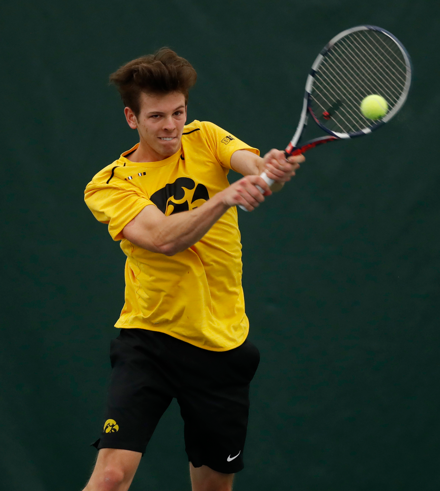 Piotr Smietana against the Illinois Fighting Illini Saturday, March 31, 2018 at Hawkeye Tennis and Recreation Center. (Brian Ray/hawkeyesports.com)