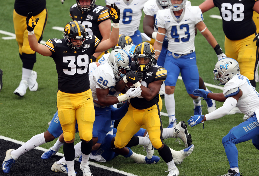 Iowa Hawkeyes tight end Nate Wieting (39) celebrates as running back Mekhi Sargent (10) scores against Middle Tennessee State Saturday, September 28, 2019 at Kinnick Stadium. (Brian Ray/hawkeyesports.com)