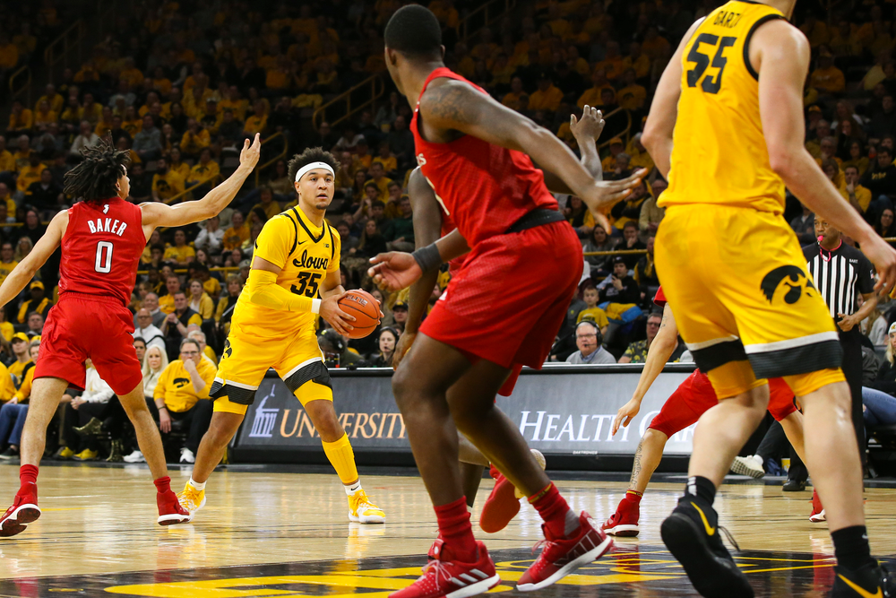 Iowa Hawkeyes forward Cordell Pemsl (35) looks to pass the ball during the Iowa men's basketball game vs Rutgers on Wednesday, January 22, 2020 at Carver-Hawkeye Arena. (Lily Smith/hawkeyesports.com)
