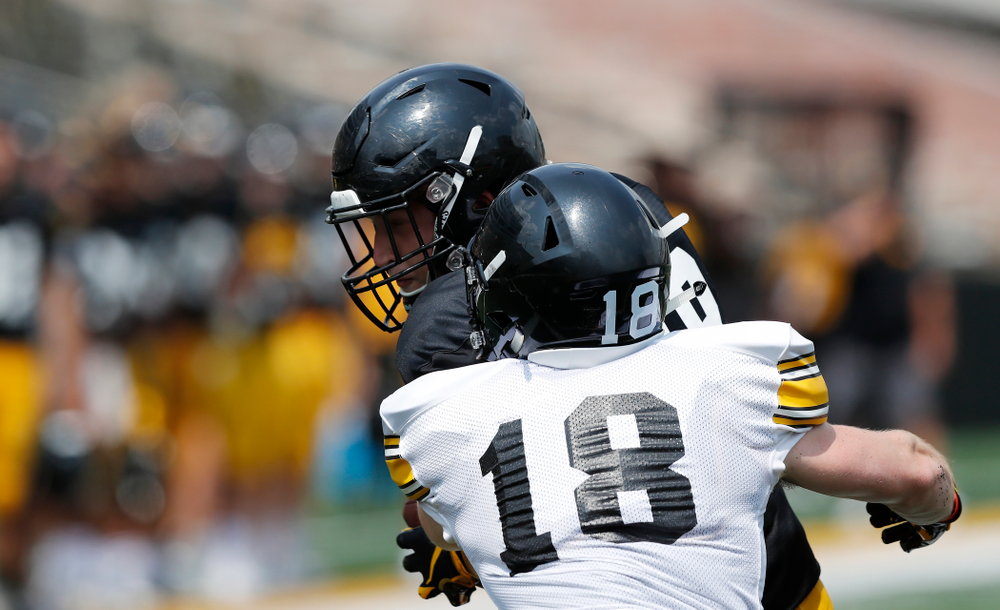 Iowa Hawkeyes tight end Drew Cook (18) and defensive back John Milani (18) during Kids Day Saturday, August 11, 2018 at Kinnick Stadium. (Brian Ray/hawkeyesports.com)