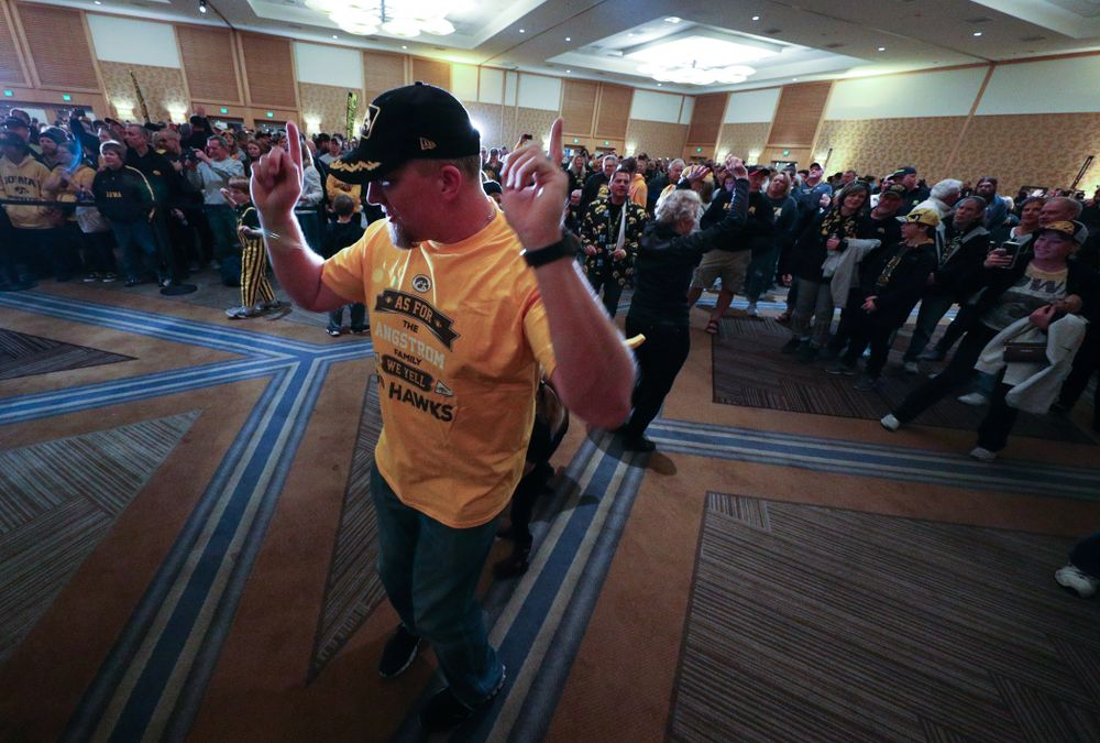 Fans dance to the Hokey Pokey in honor of the late Hayden Fry during the Holiday Bowl Hawkeye Huddle Thursday, December 26, 2019 at the Hilton in downtown San Diego. (Brian Ray/hawkeyesports.com)