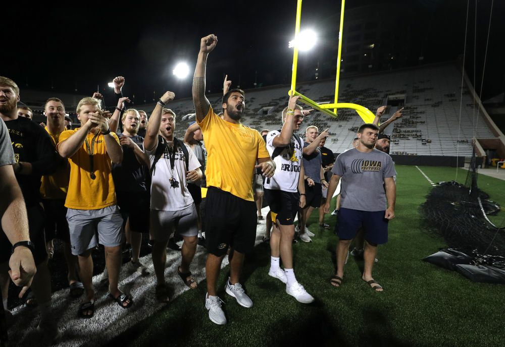 Members o the Iowa Football Team cheer on the new players as they sing the ÒFight SongÓ  Thursday, August 22, 2019 at Kinnick Stadium in Iowa City. (Brian Ray/hawkeyesports.com)