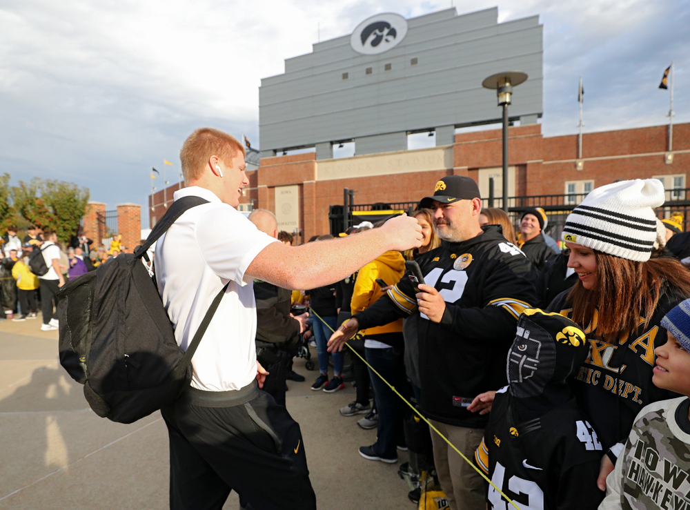 Iowa Hawkeyes tight end Shaun Beyer (42) greets fans as he arrives with his team before their game at Kinnick Stadium in Iowa City on Saturday, Oct 19, 2019. (Stephen Mally/hawkeyesports.com)