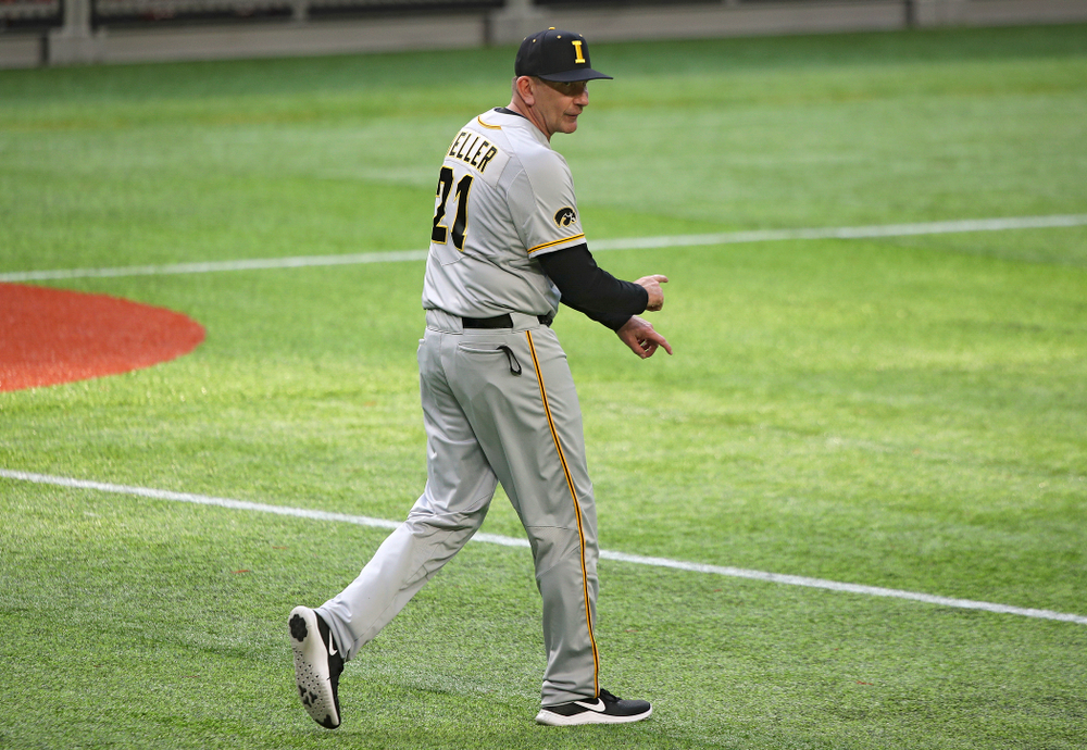 Iowa Hawkeyes head coach Rick Heller signals to bring in a relief pitcher during the eighth inning of their CambriaCollegeClassic game at U.S. Bank Stadium in Minneapolis, Minn. on Friday, February 28, 2020. (Stephen Mally/hawkeyesports.com)