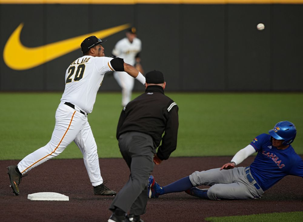 Iowa infielder Izaya Fullard (20) throws to first base as they turn a double play during the eighth inning of their college baseball game at Duane Banks Field in Iowa City on Wednesday, March 11, 2020. (Stephen Mally/hawkeyesports.com)