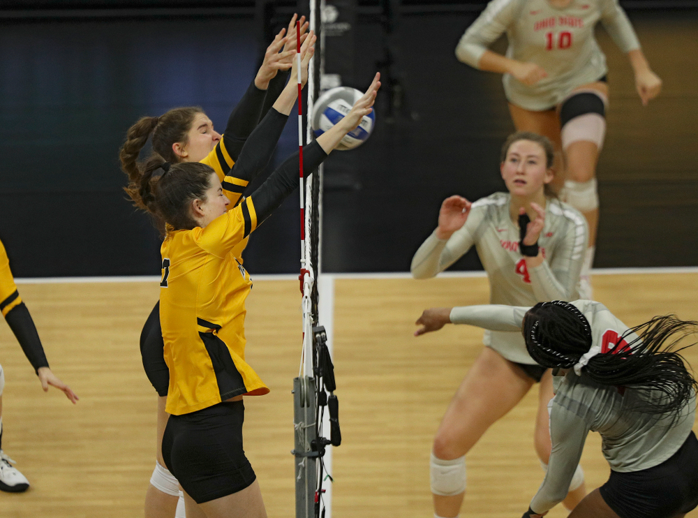 Iowa's Blythe Rients (11) and Courtney Buzzerio (2) block a shot during the third set of their match at Carver-Hawkeye Arena in Iowa City on Friday, Nov 29, 2019. (Stephen Mally/hawkeyesports.com)