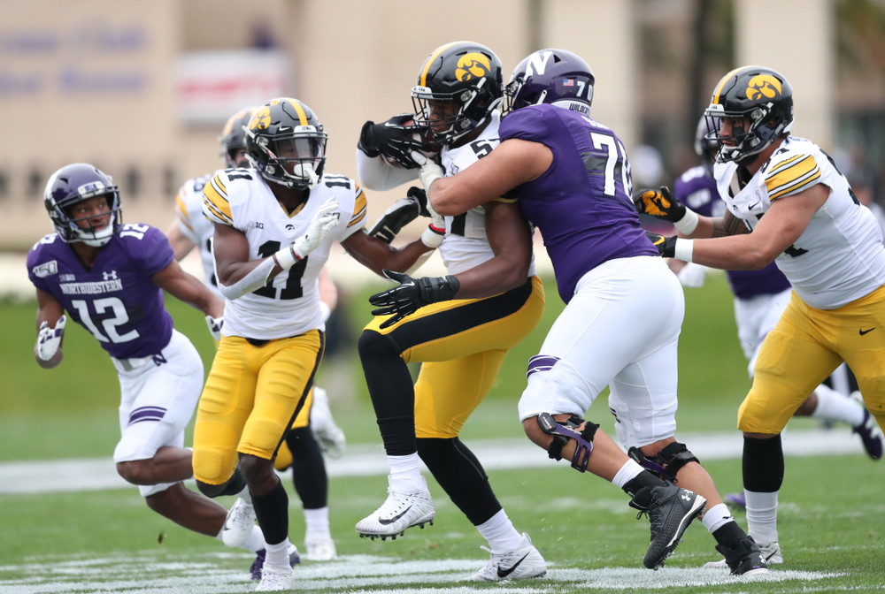 Iowa Hawkeyes defensive end Chauncey Golston (57) intercepts a pass against the Northwestern Wildcats Saturday, September 28, 2019 at Kinnick Stadium. (Max Allen/hawkeyesports.com)