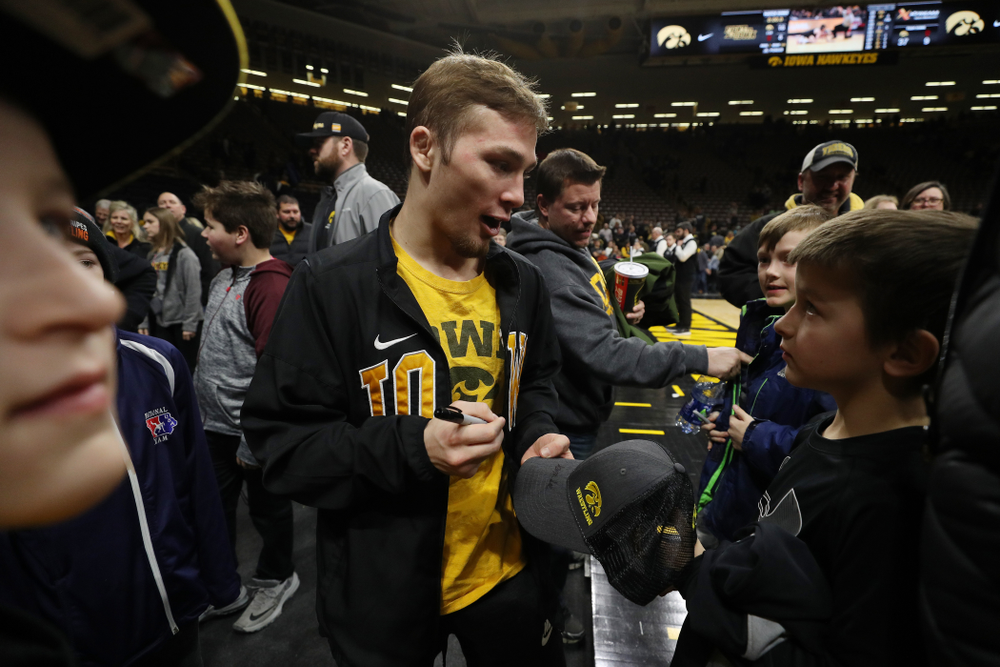 Iowa's Spencer Lee signs autographs following their meet against the Indiana Hoosiers Friday, February 15, 2019 at Carver-Hawkeye Arena. (Brian Ray/hawkeyesports.com)