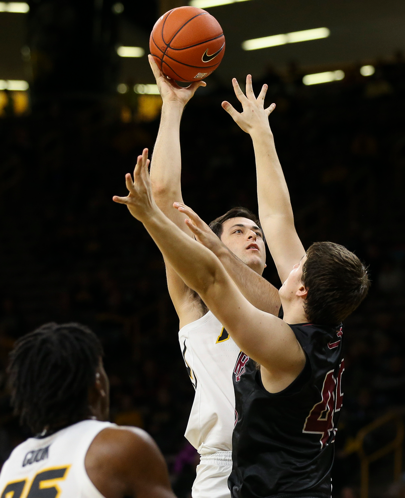 Iowa Hawkeyes forward Ryan Kriener (15) puts up a shot during a game against Guilford College at Carver-Hawkeye Arena on November 4, 2018. (Tork Mason/hawkeyesports.com)