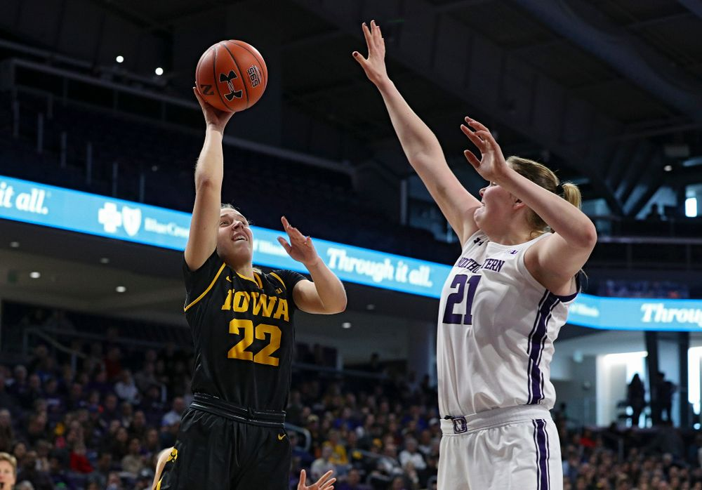 Iowa Hawkeyes guard Kathleen Doyle (22) makes a basket during the first quarter of their game at Welsh-Ryan Arena in Evanston, Ill. on Sunday, January 5, 2020. (Stephen Mally/hawkeyesports.com)