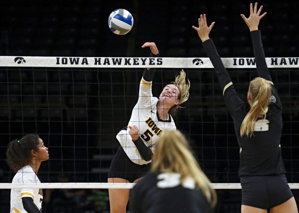 Iowa's Meghan Buzzerio (5) goes up for a kill during the first set of their Big Ten/Pac-12 Challenge match against Colorado at Carver-Hawkeye Arena in Iowa City on Friday, Sep 6, 2019. (Stephen Mally/hawkeyesports.com)
