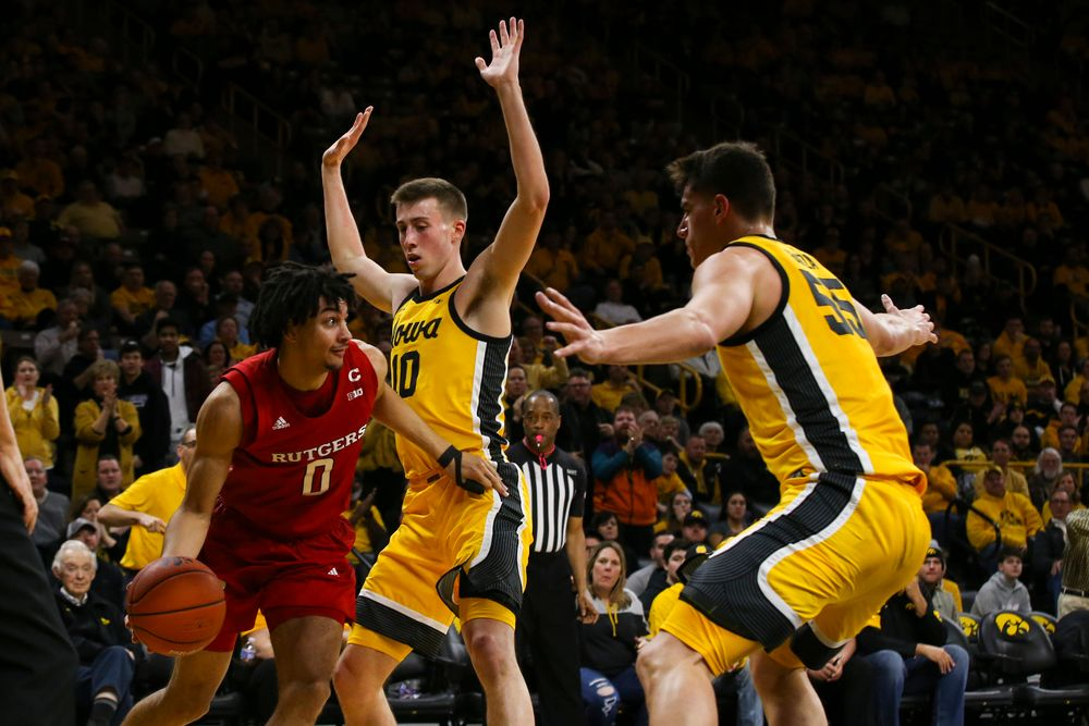 Iowa Hawkeyes guard Joe Wieskamp (10) and center Luka Garza (55) guard Rutgers' Geo Baker during the Iowa men's basketball game vs Rutgers on Wednesday, January 22, 2020 at Carver-Hawkeye Arena. (Lily Smith/hawkeyesports.com)