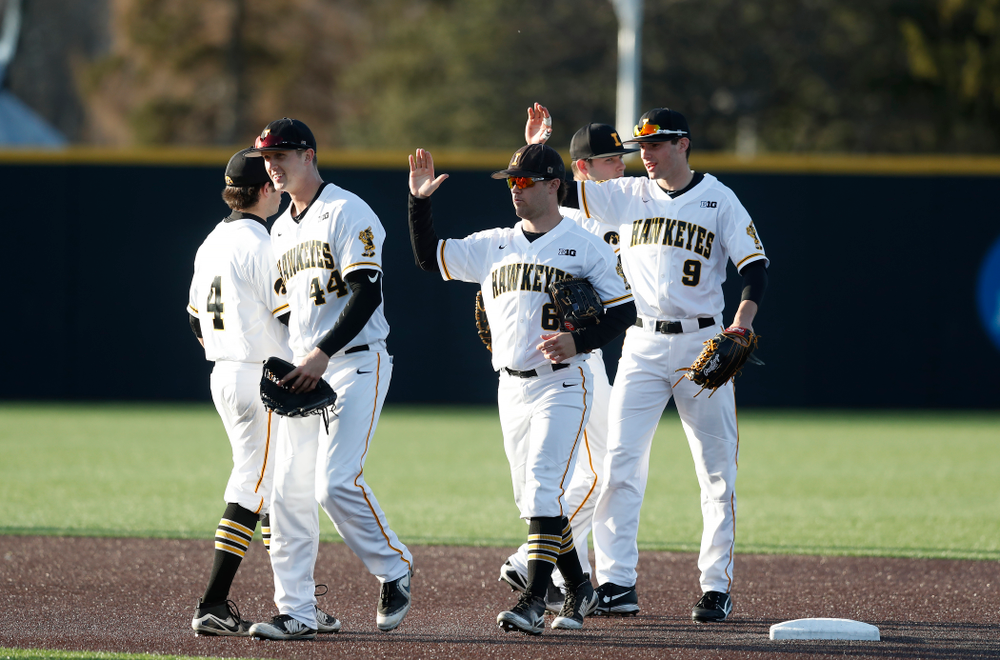 Iowa Hawkeyes outfielder Robert Neustrom (44), outfielder Justin Jenkins (6), and outfielder Ben Norman (9) against Northern Illinois Tuesday, April 17, 2018 at Duane Banks Field. (Brian Ray/hawkeyesports.com)