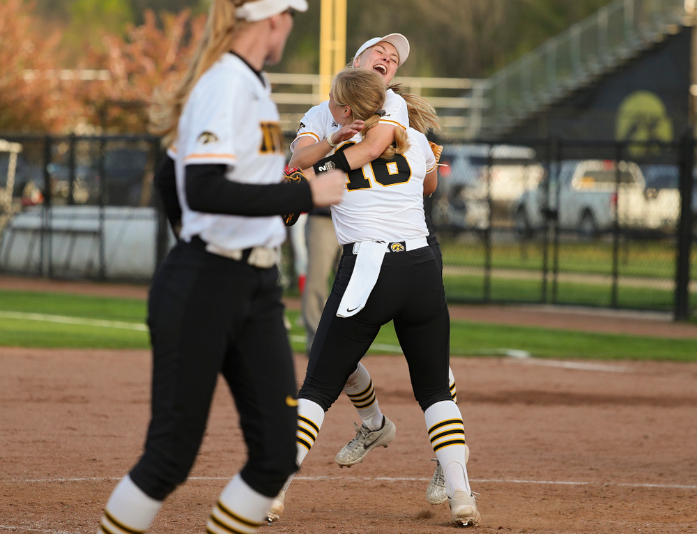 Iowa second baseman Aralee Bogar (2) jumps into the arms of pitcher Sarah Lehman (16) after winning their game against Ohio State at Pearl Field in Iowa City on Friday, May. 3, 2019. (Stephen Mally/hawkeyesports.com)