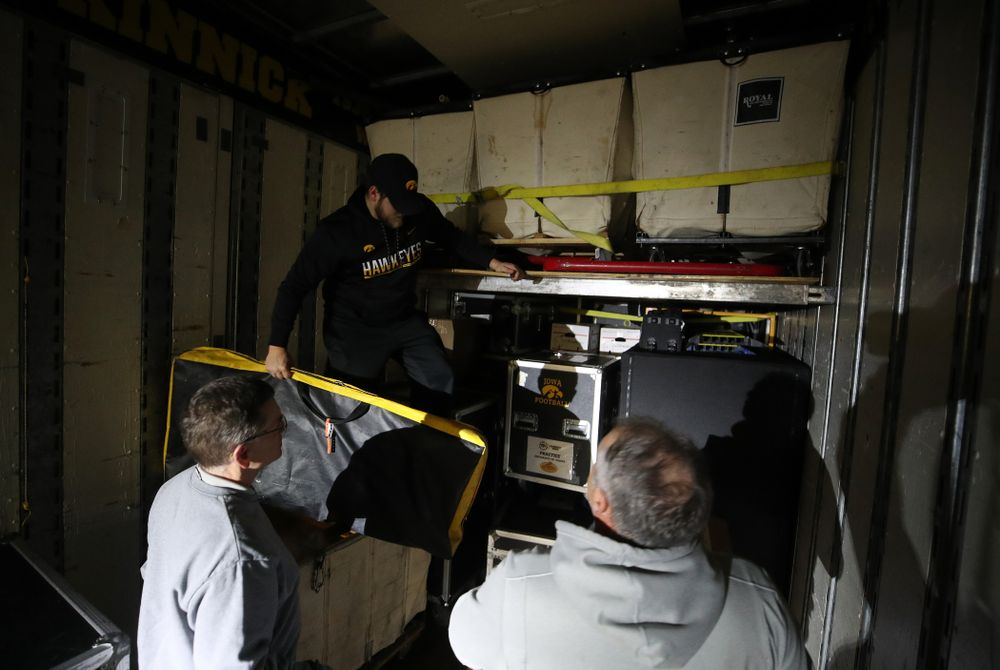 Members fo the Hawkeye Football equipment staff and managers load equipment onto the truck bound for Tampa for the Outback Bowl Wednesday, December 19, 2018 at the Hansen Football Performance Center.  (Brian Ray/hawkeyesports.com)
