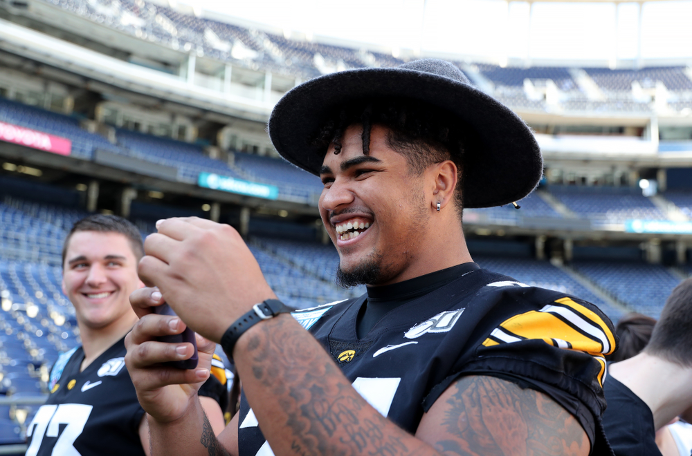 Iowa Hawkeyes offensive lineman Tristan Wirfs (74) following the team photo Wednesday, December 25, 2019 at SDCCU Stadium in San Diego. (Brian Ray/hawkeyesports.com)