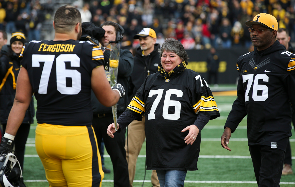 Iowa Hawkeyes offensive lineman Dalton Ferguson (76) is greeted by his parents during Senior Day ceremonies before a game against Nebraska at Kinnick Stadium on November 23, 2018. (Tork Mason/hawkeyesports.com)