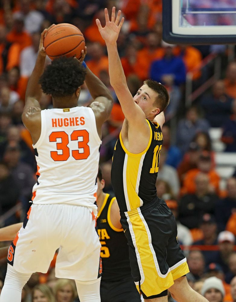 Iowa Hawkeyes guard Joe Wieskamp (10) tries to block a shot by Syracuse Orange forward Elijah Hughes (33) during the first half of their ACC/Big Ten Challenge game at the Carrier Dome in Syracuse, N.Y. on Tuesday, Dec 3, 2019. (Stephen Mally/hawkeyesports.com)