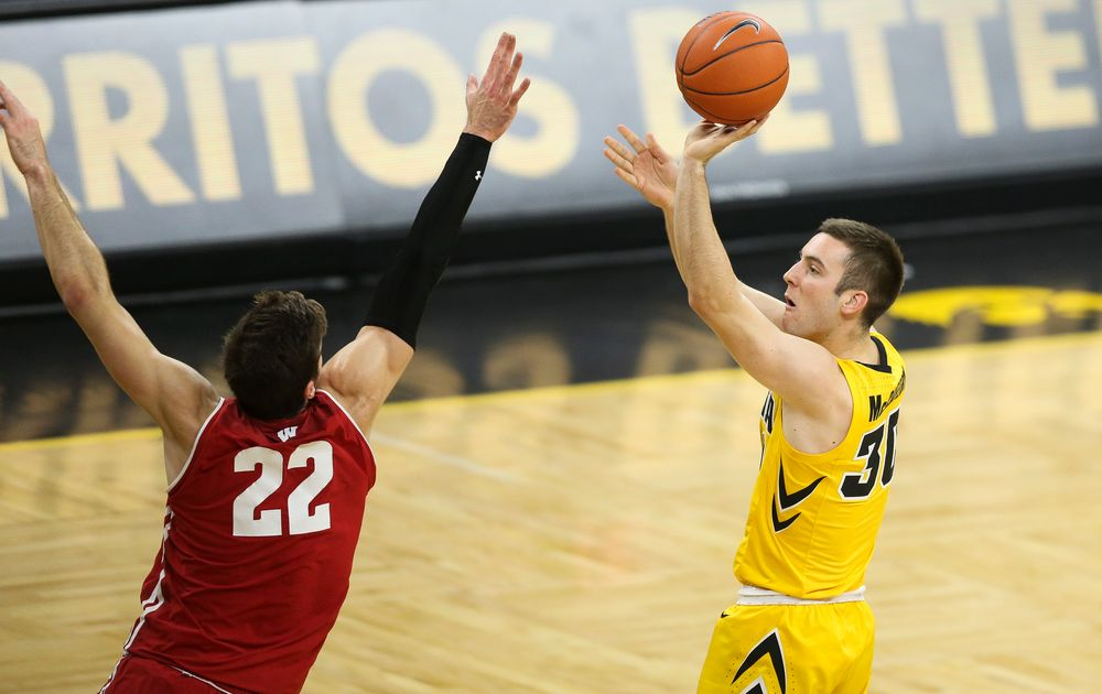 Iowa Hawkeyes guard Connor McCaffery (30) shoots the ball against Wisconsin on November 30, 2018 at Carver-Hawkeye Arena. (Tork Mason/hawkeyesports.com)