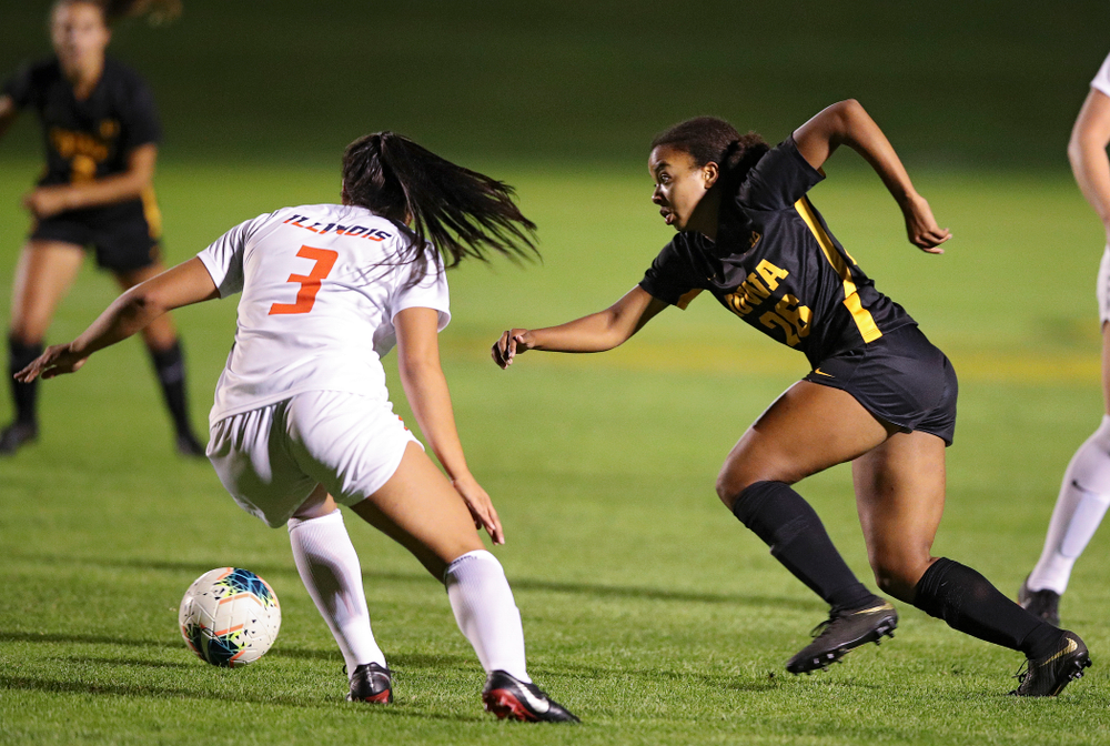 Iowa midfielder/forward Melina Hegelheimer (26) tries to get around a defender during the first half of their match against Illinois at the Iowa Soccer Complex in Iowa City on Thursday, Sep 26, 2019. (Stephen Mally/hawkeyesports.com)