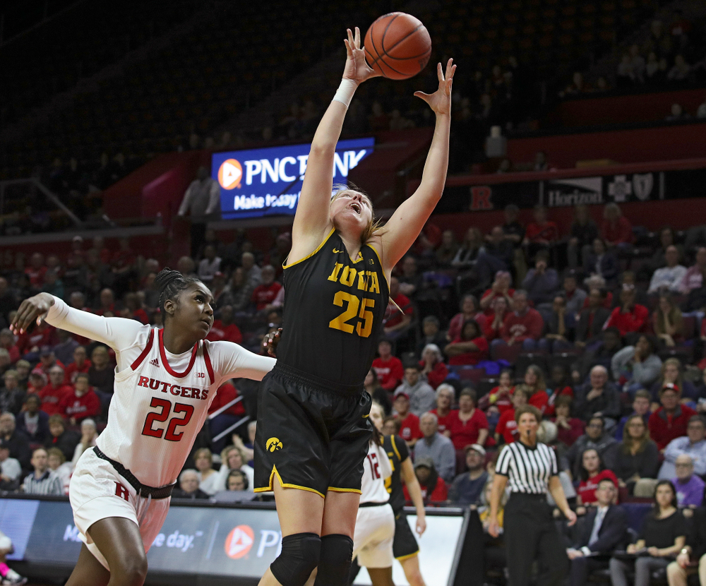 Iowa forward/center Monika Czinano (25) pulls in a pass during the fourth quarter of their game at the Rutgers Athletic Center in Piscataway, N.J. on Sunday, March 1, 2020. (Stephen Mally/hawkeyesports.com)