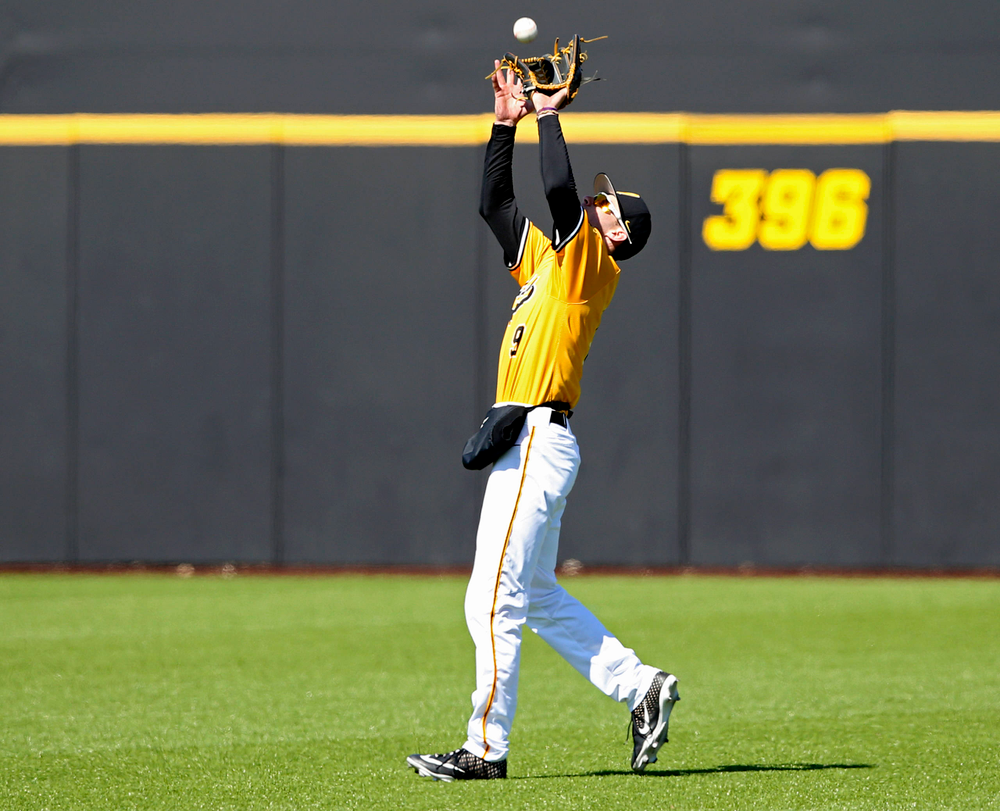 Iowa Hawkeyes center fielder Ben Norman (9) pulls in a fly ball for an out during the sixth inning against Illinois at Duane Banks Field in Iowa City on Sunday, Mar. 31, 2019. (Stephen Mally/hawkeyesports.com)