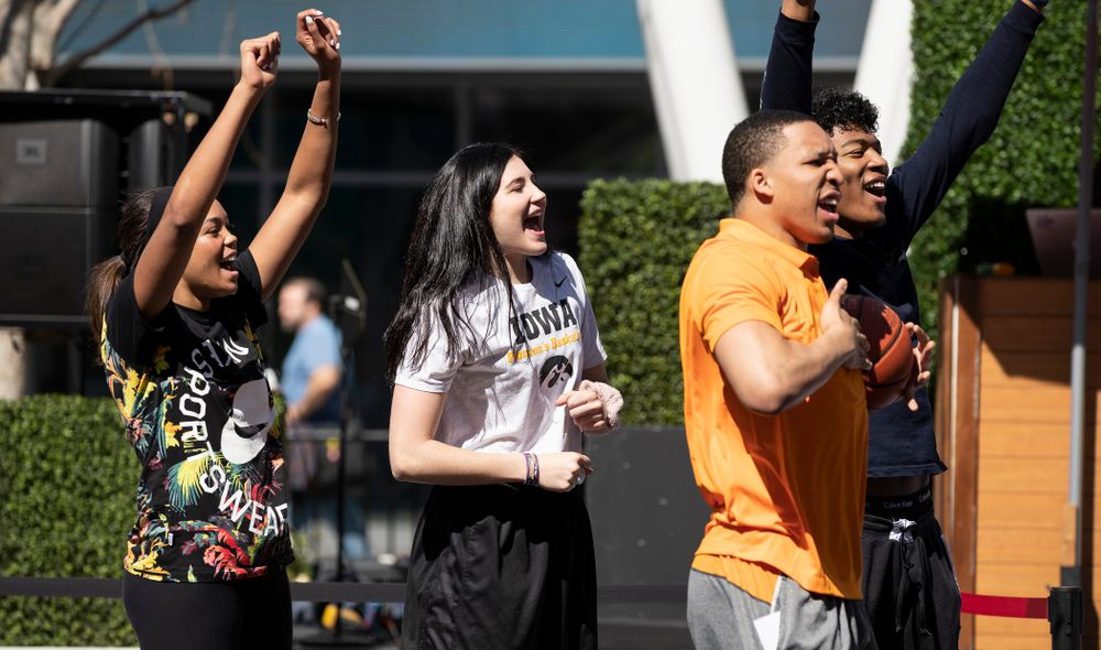 Iowa Hawkeyes forward Megan Gustafson (10) cheers on the athletes during a Special Olympics Event Friday, April 12, 2019 in the XBOX Plaza at LA Live.  (Brian Ray/hawkeyesports.com)