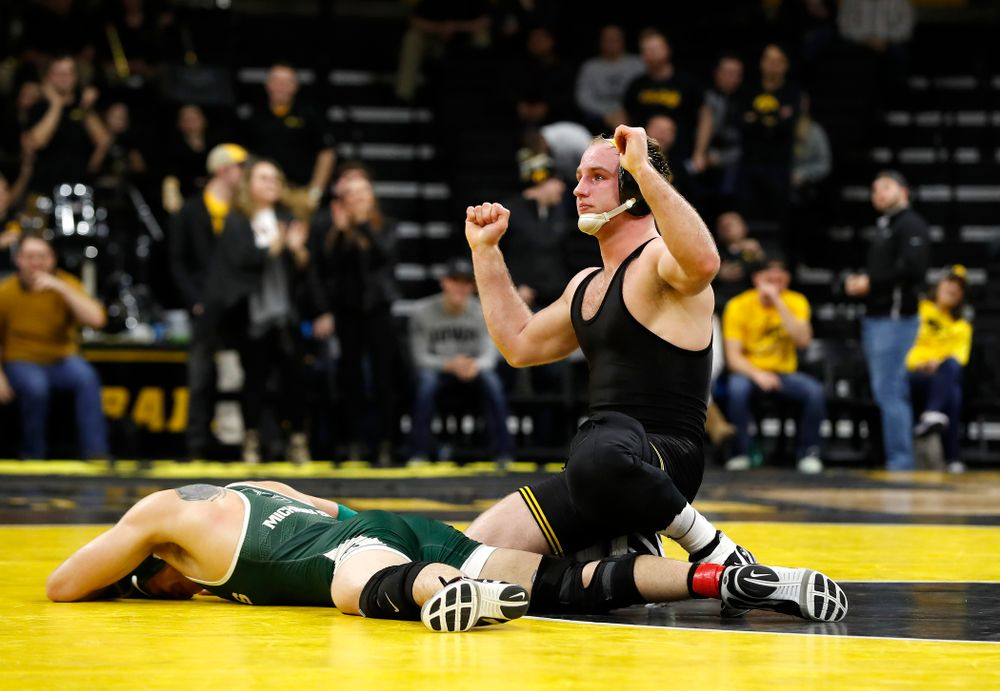 Iowa's Alex Marinelli tech falls Michigan State's Austin Hiles at 165 pounds.