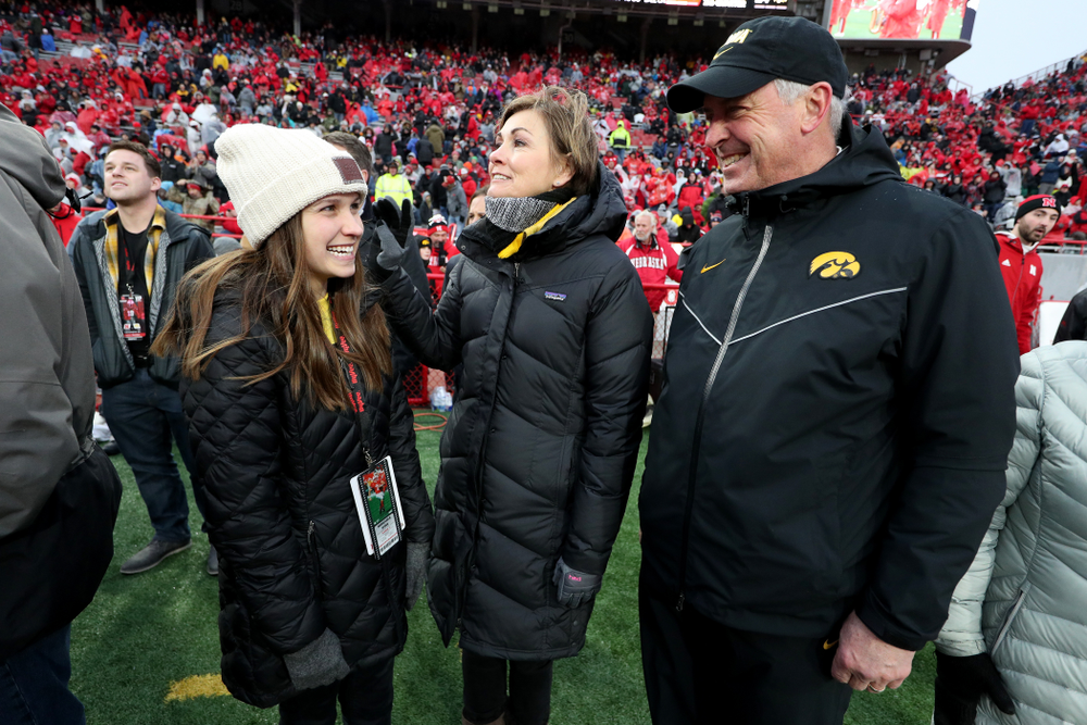 Iowa hero Katie Gudenkauf talks with Iowa Governor Kim Reynolds and Henry B. and Patricia B. Tippie Director of Athletics Chair Gary Barta at half-time of the Iowa Hawkeyes game against the Nebraska Cornhuskers Friday, November 29, 2019 at Memorial Stadium in Lincoln, Neb. (Brian Ray/hawkeyesports.com)
