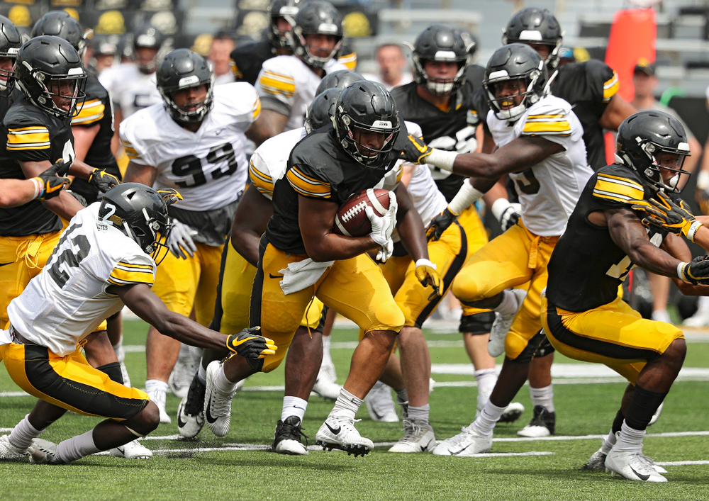 Iowa Hawkeyes running back Toren Young (28) on a run during Fall Camp Practice No. 8 at Kids Day at Kinnick Stadium in Iowa City on Saturday, Aug 10, 2019. (Stephen Mally/hawkeyesports.com)