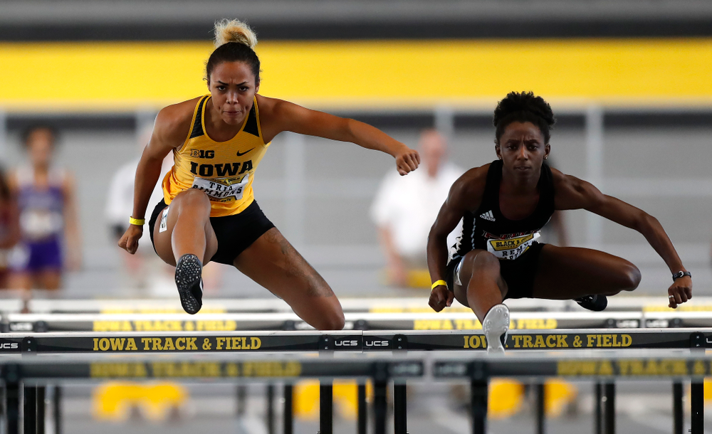 Tria Simmons competes in the 60 meter hurdles