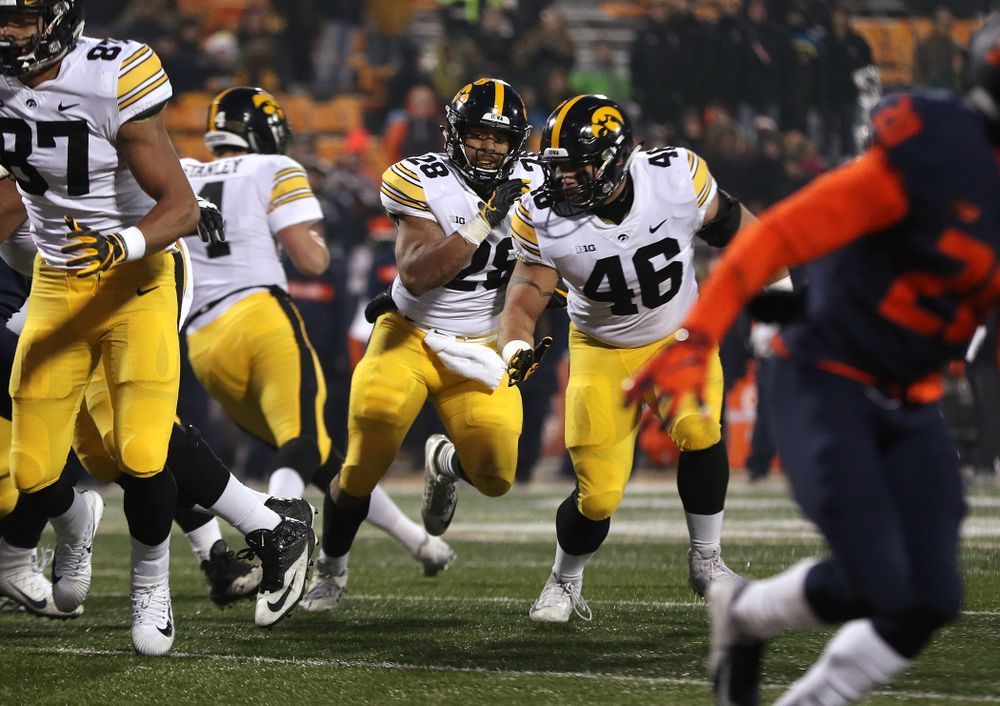 Iowa Hawkeyes running back Toren Young (28) runs behind fullback Austin Kelly (46) against the Illinois Fighting Illini Saturday, November 17, 2018 at Memorial Stadium in Champaign, Ill. (Brian Ray/hawkeyesports.com)