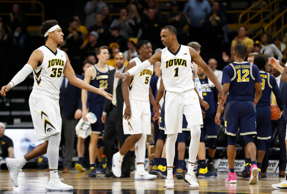 Iowa Hawkeyes forward Cordell Pemsl (35) and guard Maishe Dailey (1)