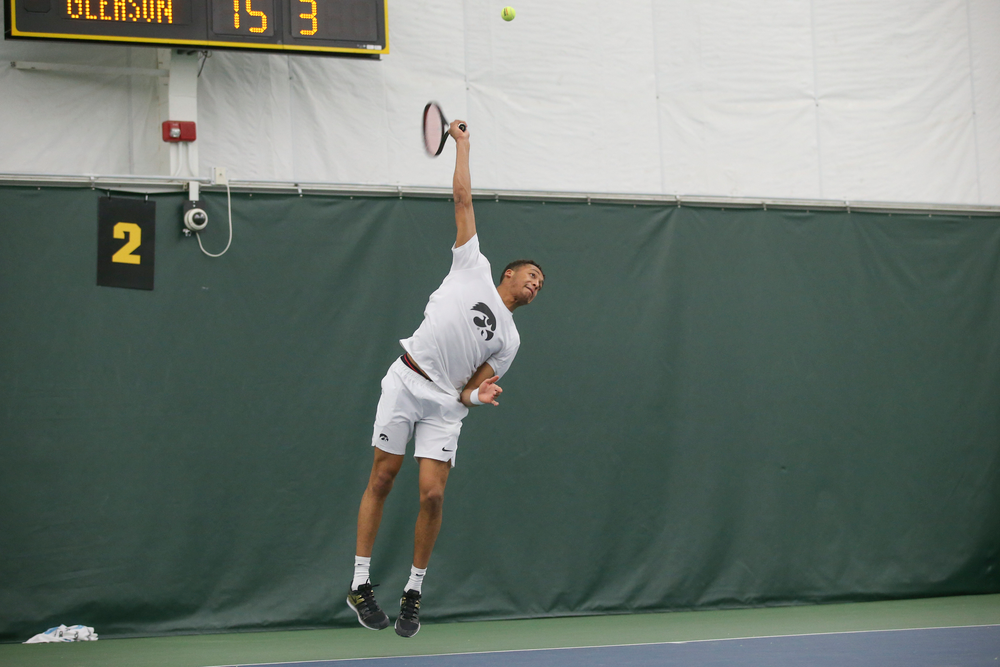 Iowa's Oliver Okonkwo serves the ball during the Iowa men's tennis meet vs Nebraska on Sunday, March 1, 2020 at the Hawkeye Tennis and Recreation Complex. (Lily Smith/hawkeyesports.com)