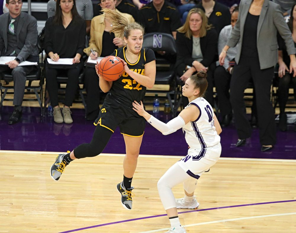 Iowa Hawkeyes guard Kathleen Doyle (22) pulls in a pass during the fourth quarter of their game at Welsh-Ryan Arena in Evanston, Ill. on Sunday, January 5, 2020. (Stephen Mally/hawkeyesports.com)