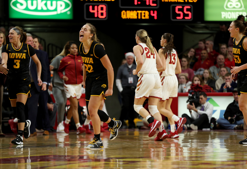 Iowa Hawkeyes guard Kathleen Doyle (22) celebrates against the Iowa State Cyclones Wednesday, December 11, 2019 at Hilton Coliseum in Ames, Iowa(Brian Ray/hawkeyesports.com)