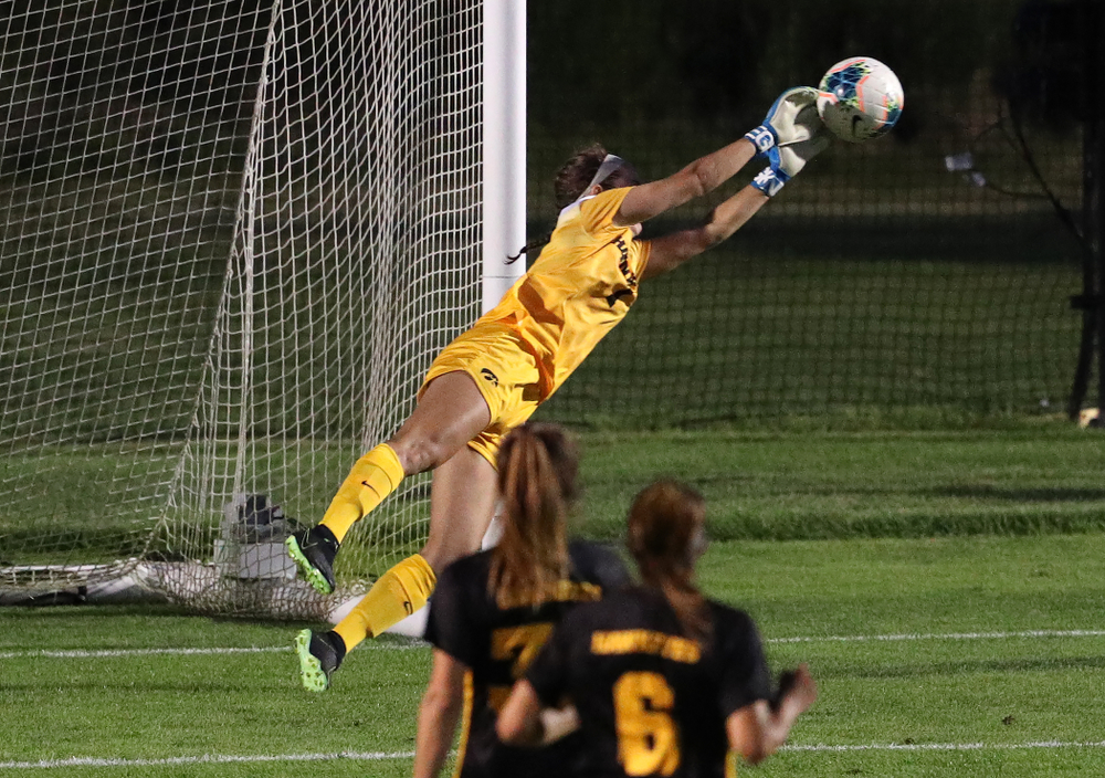 Iowa Hawkeyes goalkeeper Claire Graves (1) makes a diving save against Western Michigan Thursday, August 22, 2019 at the Iowa Soccer Complex. (Brian Ray/hawkeyesports.com)