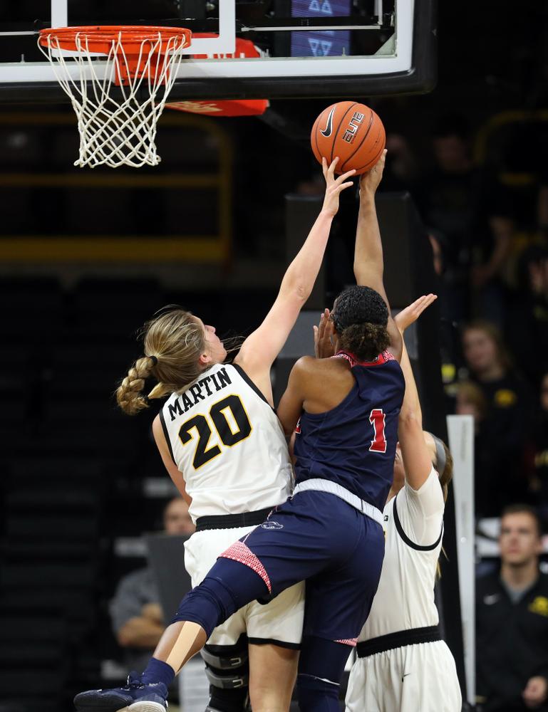 Iowa Hawkeyes guard Kate Martin (20) blocks a shot against Florida Atlantic University Thursday, November 7, 2019 at Carver-Hawkeye Arena. (Brian Ray/hawkeyesports.com)
